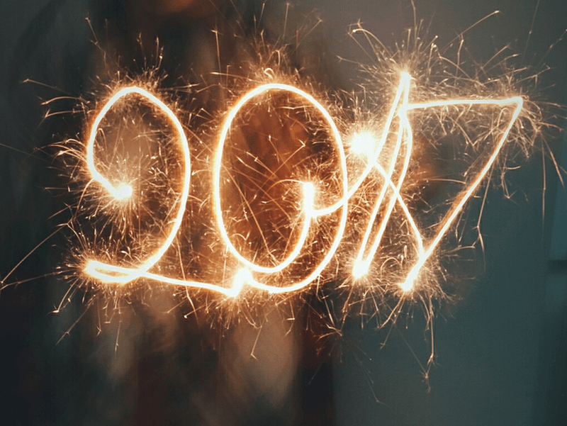 Image shows a sparkler writing out the number 2017