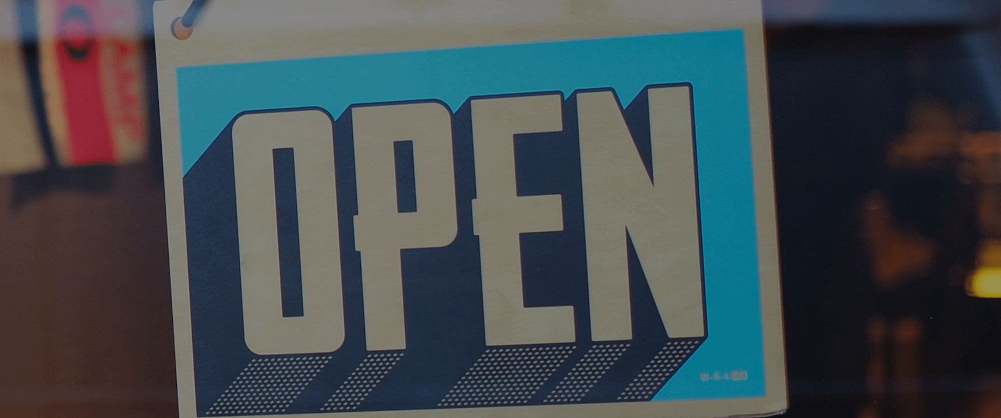 Banner showing open sign in shop window
